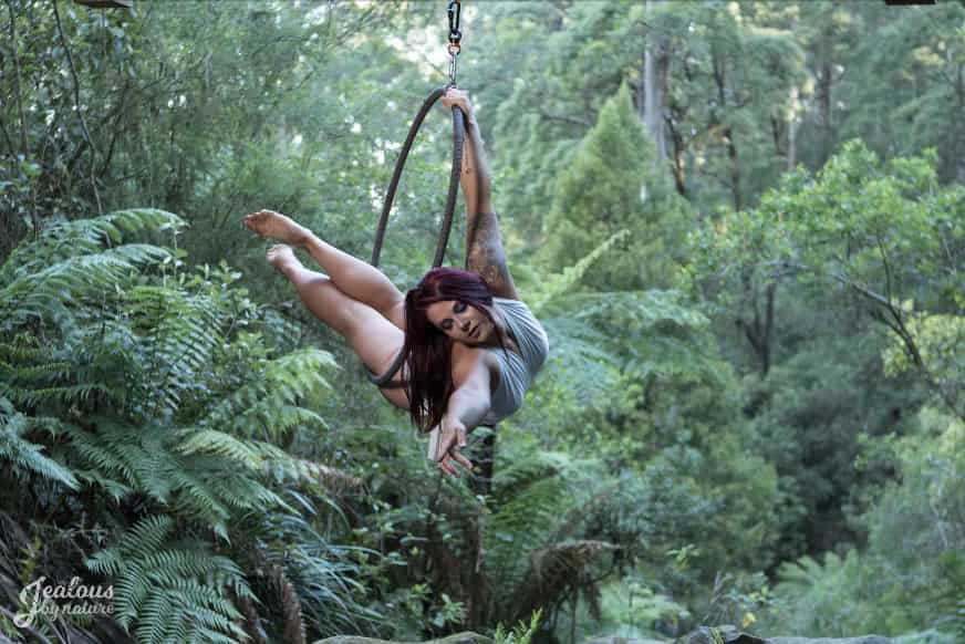 Woman in lyra hoop in nature photoshoot arched back hanging, aerial classes, aerial silk classes, aerial silks, aerial fitness